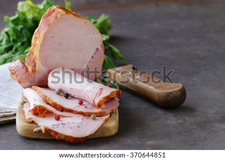 piece of roasted meat (ham) with pepper and thyme
