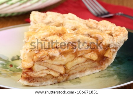 Piece of sliced apple pie on a plate - stock photo