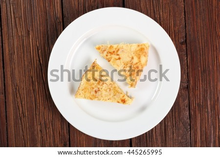 Piece of Spanish omelette on plate. Directly Above. - stock photo