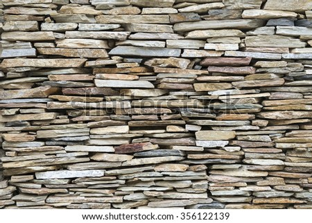 piece of stone in various size cladding on wall - stock photo