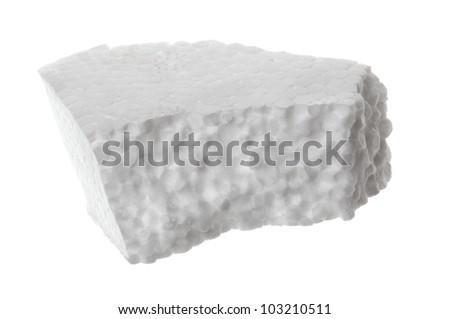 Piece of Styrofoam on white background - stock photo