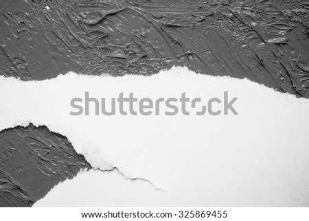 Piece of torn paper on grey - stock photo