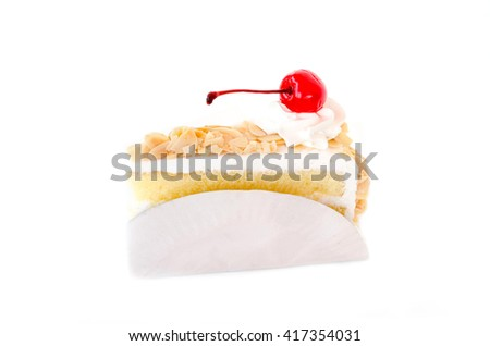 Piece of vanilla layer cake with almonds on white background - stock photo