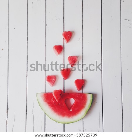 Piece of watermelon and hearts at white background. Flat lay - stock photo