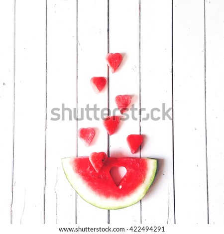 Piece of watermelon and hearts at white background, flat lay composition - stock photo