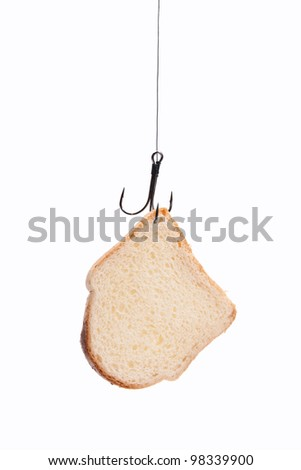 piece of white bread hanging on a fishing hook. isolated - stock photo