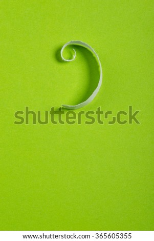 Piece of white torn paper over the green background - stock photo