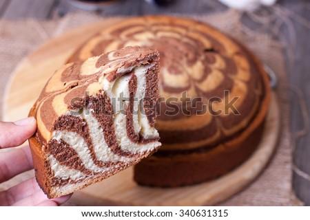 Piece of ''Zebra'' cake  - stock photo
