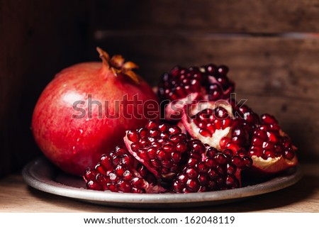 Pieces and grains of ripe pomegranate - stock photo
