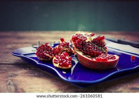 Pieces and seeds of ripe pomegranate - stock photo
