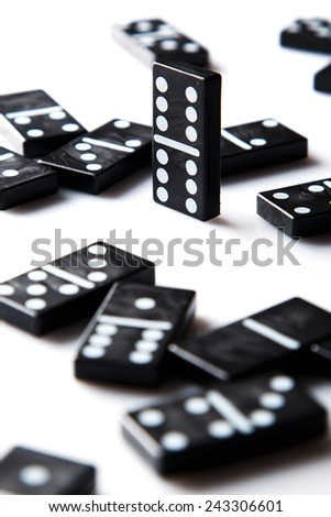 Pieces of  black domino tiles