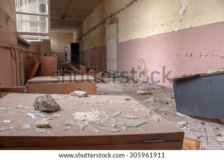 Pieces of broken glass among destroyed desks and lockers in an abandoned corridor  in an old school building Sofia, Bulgaria, May 12, 2014. Some of the doors and windows had been wrecked.