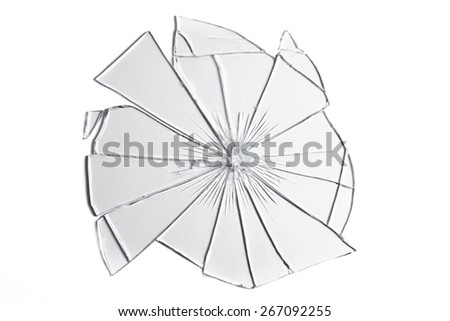 Pieces of broken glass reassembled to form a shape. - stock photo