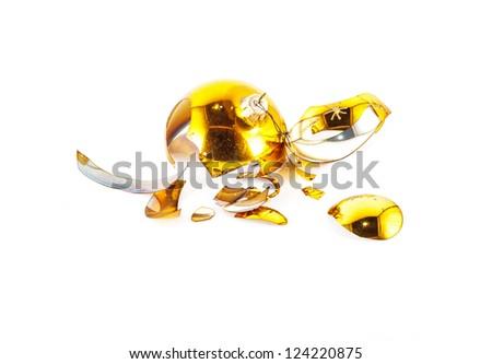 Pieces of broken yellow Christmas ball - stock photo