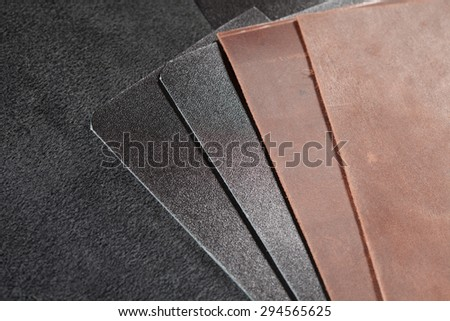 Pieces of brown and black leather. nubuck pieces of brown and black leather - stock photo