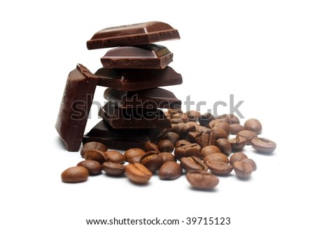 Pieces of chocolate and coffee beans - stock photo