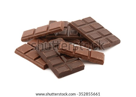 pieces of chocolate in the foreground on white background