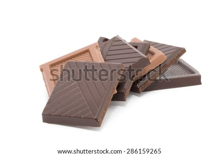 pieces of Chocolate isolated on white - stock photo