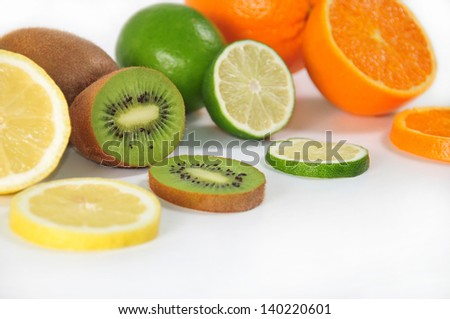 pieces of citric fruits, with slices, on white bottom - stock photo