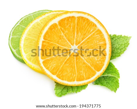 Pieces of citrus fruits isolated on white - stock photo
