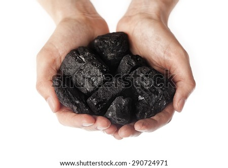 Pieces of coal in hand isolated on white background   - stock photo