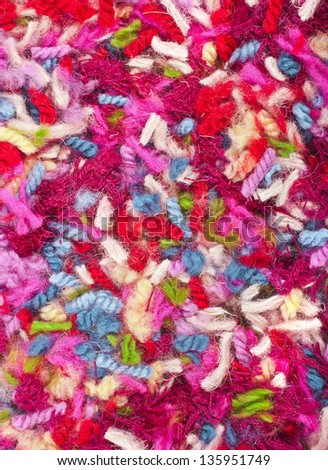 pieces of colored yarn threads surface top view - stock photo