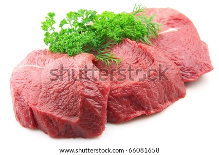 Pieces of crude meat with parsley and fennel - stock photo