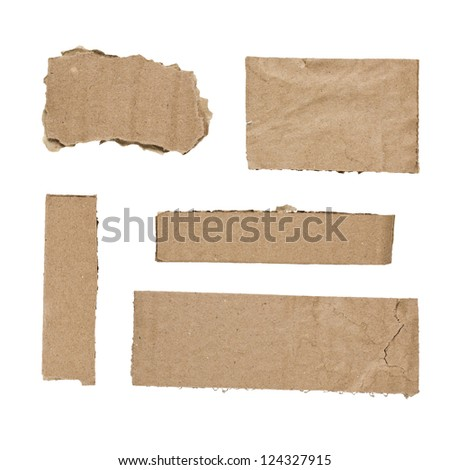 Pieces of cut cardboard isolated on white background