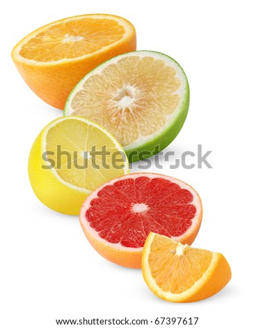Pieces of different citrus fruits isolated on white - stock photo