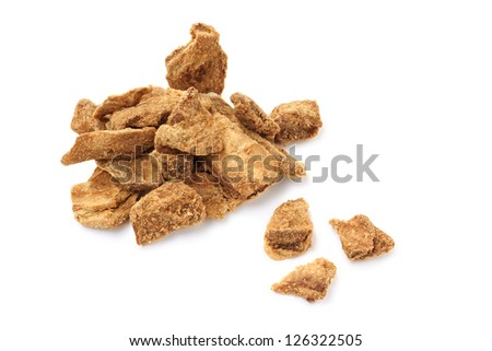 pieces of  dried meat on white background