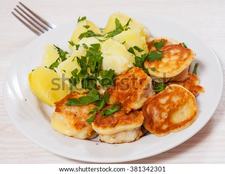 pieces of fish fillets in batter with potato - stock photo