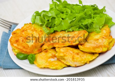 pieces of fish fillets in batter with salad - stock photo