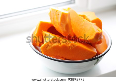 pieces of fresh raw pumpkin in a bowl - stock photo