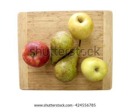 pieces of fruit on a wooden surface