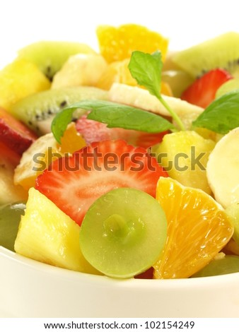 Pieces of fruits in fresh healthy salad