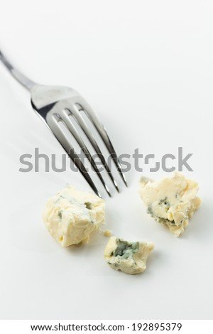 Pieces of Gorgonzola Cheese with fork - stock photo