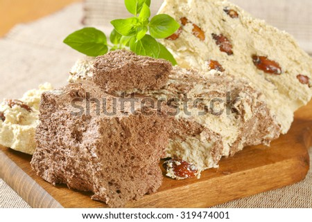 Pieces of halva on a cutting board - stock photo