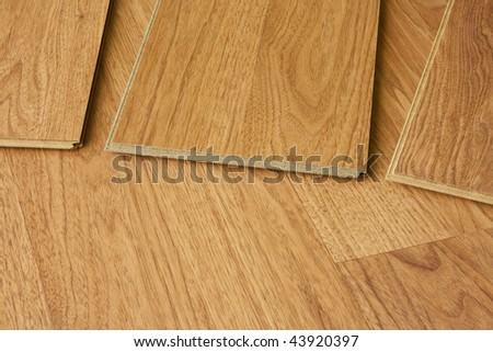 pieces of hardwood flooring showing tongue and groove - stock photo