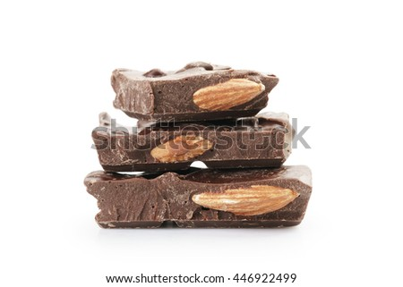 pieces of homemade dark chocolate with almonds, isolated on white background - stock photo