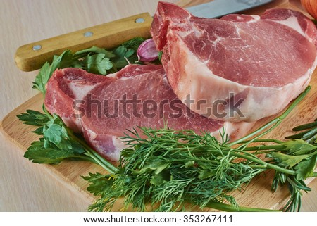 pieces of meat close up on a chopping board before preparation