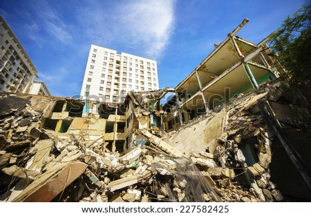 Pieces of Metal and Stone are Crumbling from Demolished Building Floors in Hochiminh city, Vietnam. there are many old apartment buildings are full demolition to new construction in Ho Chi Minh City - stock photo
