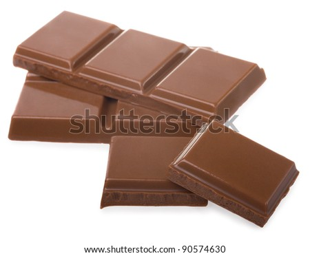 Pieces of milk chocolate isolated on white - stock photo