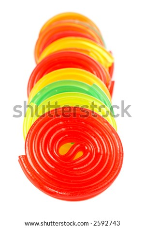 Pieces of multicolored licorices with soft shadow on white background - stock photo