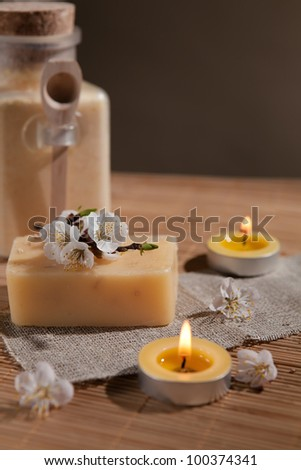 Pieces of natural soap  and flowers.