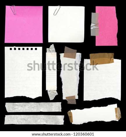 Pieces of paper and adhesive tape on black - stock photo