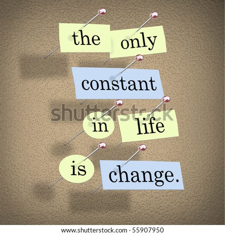 Pieces of paper each containing a word pinned to a cork board reading the only constant in life is change - stock photo