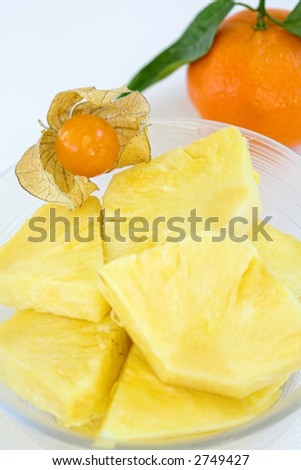 Pieces of pineapple, physalis and tangerine