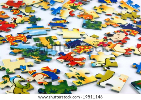 Pieces of puzzle on white background - stock photo