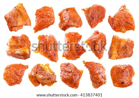 Pieces of raw pork isolated on white background. Chunks of barbecue in a sauce isolated with a clipping path. - stock photo
