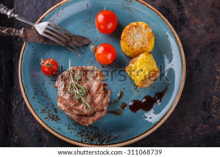 Pieces of red meat, steaks with vegetable and spices.selective focus - stock photo
